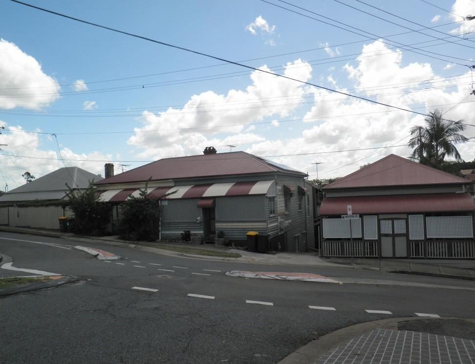 This is an image of the Heritage Place known as the Merton Road Cottages located at 51, 53, 55 and 57 Merton Road in Woolloongabba